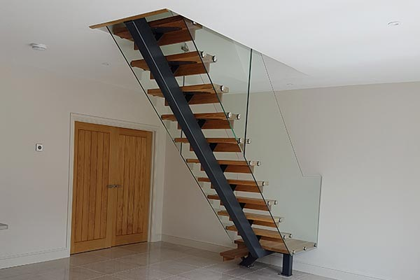 Central-spine-and-glass-balustrade-staircase